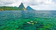 Snorkeling Over Pristine Reefs with Stunning Piton Backdrop